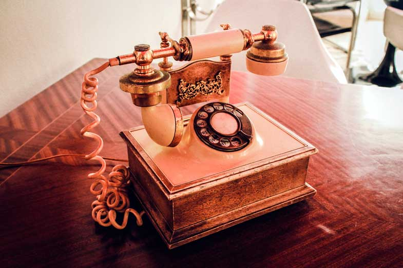 the old telephone signfies the past